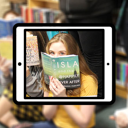 Teenager with book in iPad